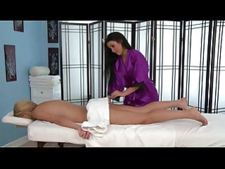 Lesbian masseuse babe at work